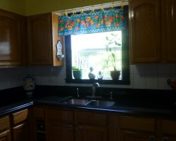 Cambrian Black Granite Countertops and Window Frame